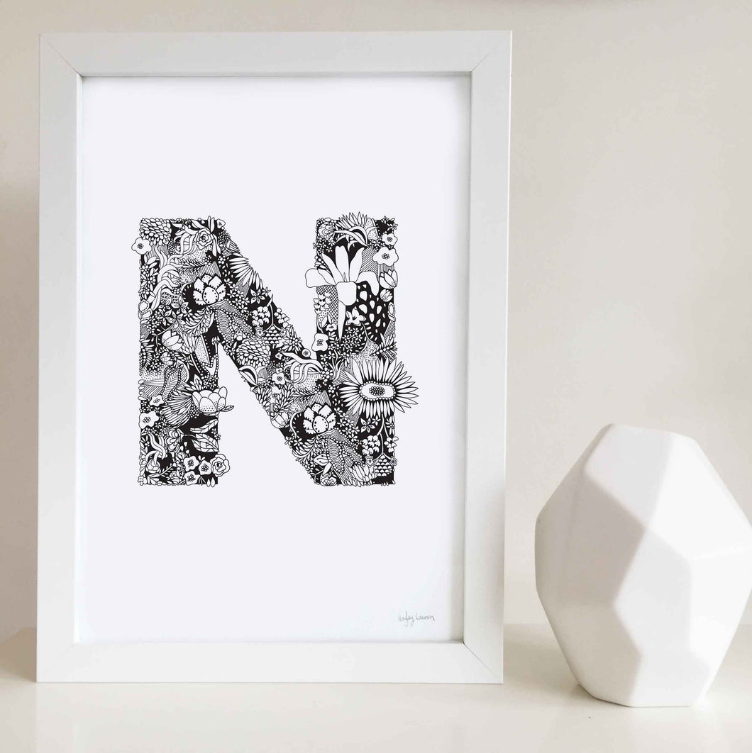 The floral letter 'N' artwork was illustrated by Hayley Lauren in Melbourne, Australia. It is the perfect artwork to personalise a nursery or kids bedroom.