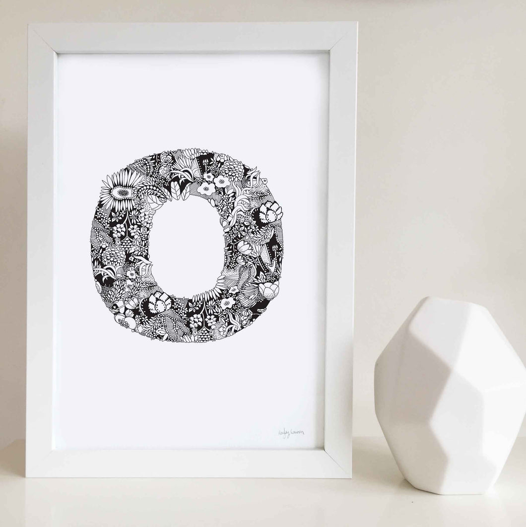 The floral letter 'O' artwork was illustrated by Hayley Lauren in Melbourne, Australia. It is the perfect artwork to personalise a nursery or kids bedroom.