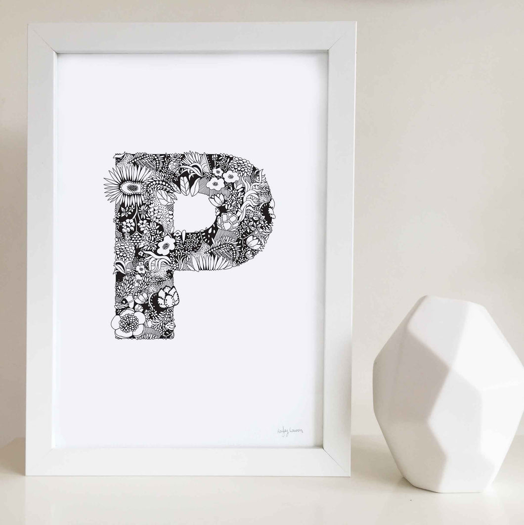 The floral letter 'P' artwork was illustrated by Hayley Lauren in Melbourne, Australia. It is the perfect artwork to personalise a nursery or kids bedroom.