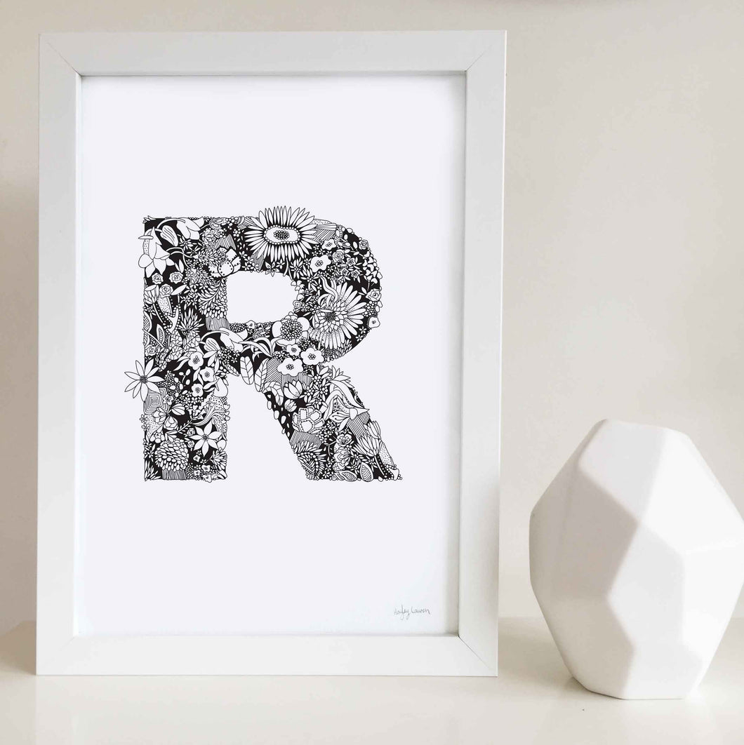 The floral letter 'R' artwork was illustrated by Hayley Lauren in Melbourne, Australia. It is the perfect artwork to personalise a nursery or kids bedroom.