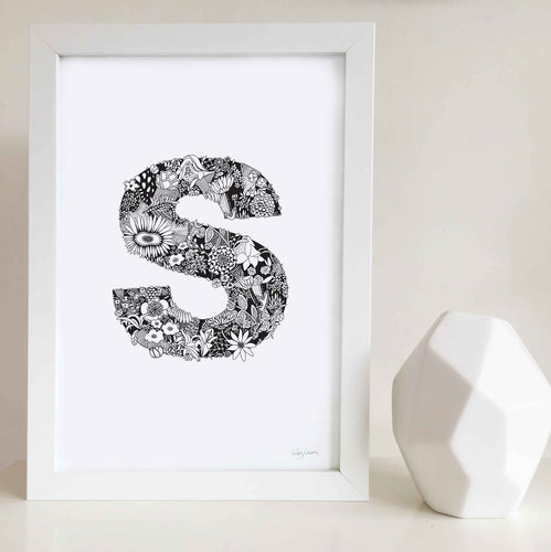 The floral letter 'S' artwork was illustrated by Hayley Lauren in Melbourne, Australia. It is the perfect artwork to personalise a nursery or kids bedroom.