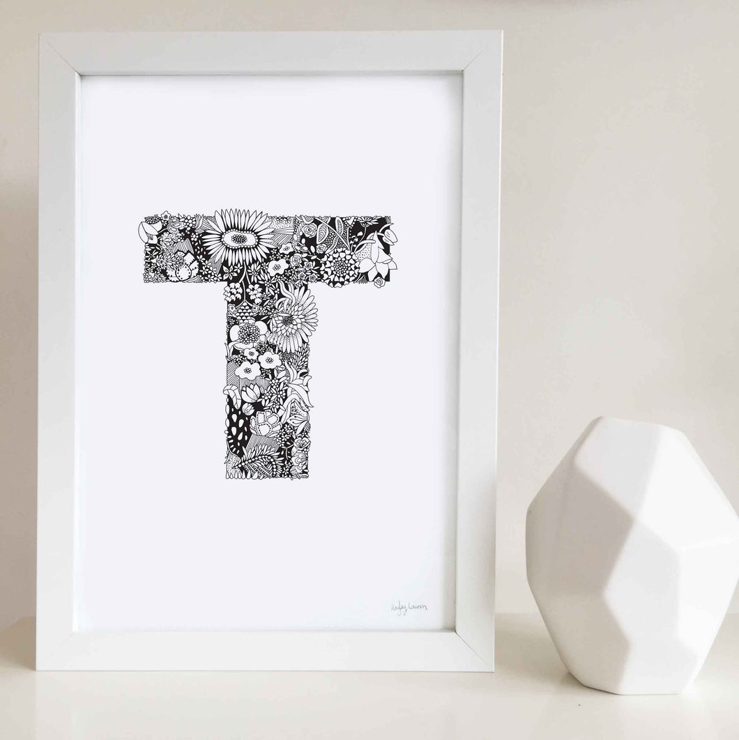 The floral letter 'T' artwork was illustrated by Hayley Lauren in Melbourne, Australia. It is the perfect artwork to personalise a nursery or kids bedroom.