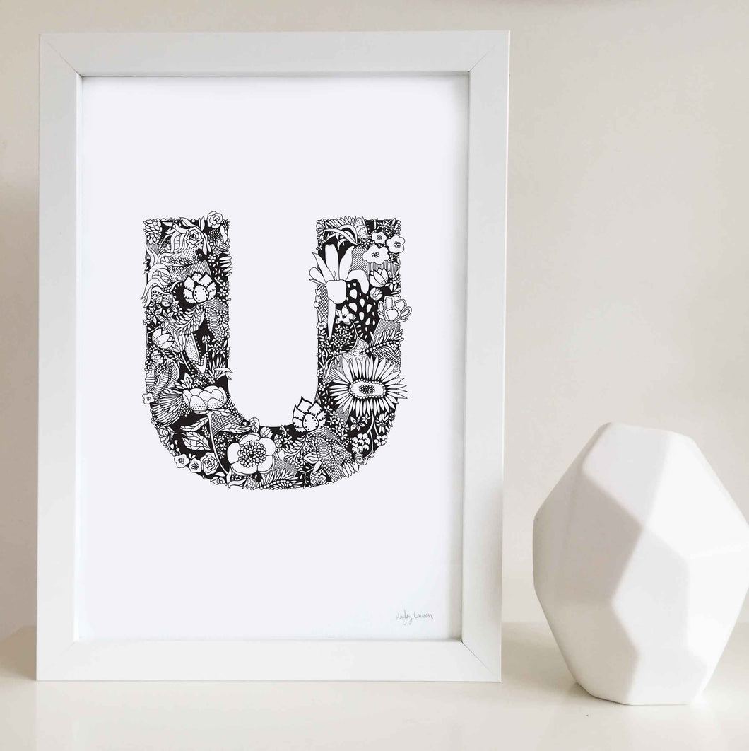 The floral letter 'U' artwork was illustrated by Hayley Lauren in Melbourne, Australia. It is the perfect artwork to personalise a nursery or kids bedroom.