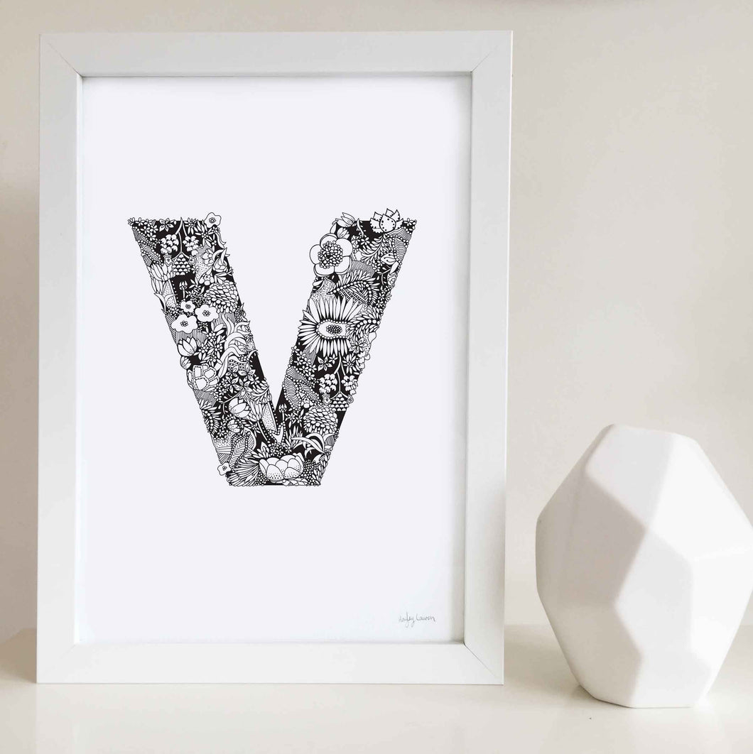 The floral letter 'V' artwork was illustrated by Hayley Lauren in Melbourne, Australia. It is the perfect artwork to personalise a nursery or kids bedroom.
