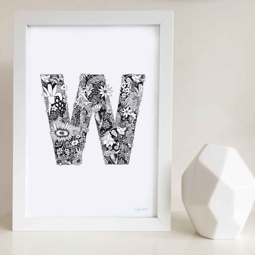 The floral letter 'W' artwork was illustrated by Hayley Lauren in Melbourne, Australia. It is the perfect artwork to personalise a nursery or kids bedroom.