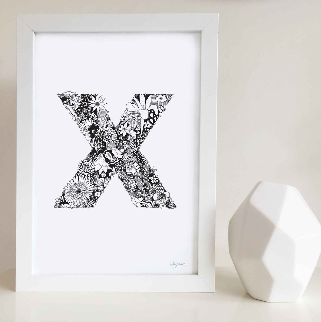 The floral letter 'X' artwork was illustrated by Hayley Lauren in Melbourne, Australia. It is the perfect artwork to personalise a nursery or kids bedroom.