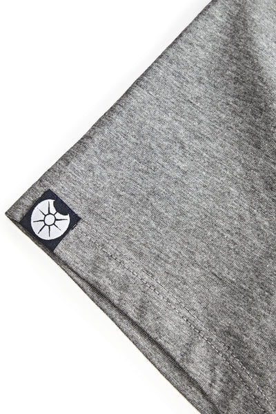 A close up of the small symbol on the right sleeve of the Morph T-shirt depicting ones size. In this photo the Achilles symbol, a shield, is shown.