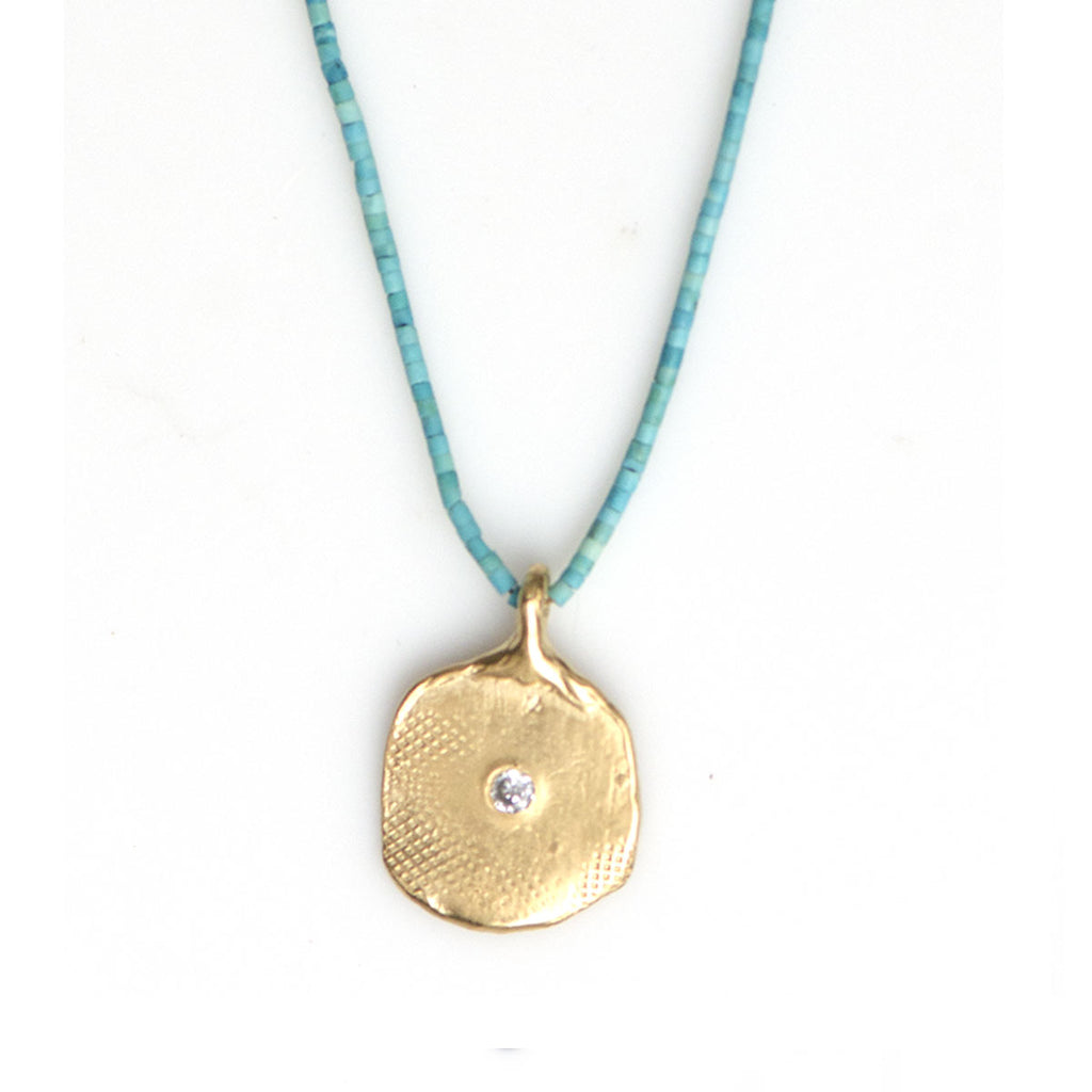 TEXTURED PAPER IMPRINT NECKLACE ON TURQUOISE | KEELY SMITH JEWELRY DESIGNS