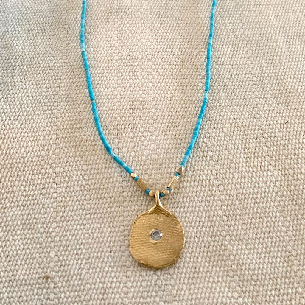TEXTURED PAPER IMPRINT NECKLACE ON TURQUOISE - 308NLGT