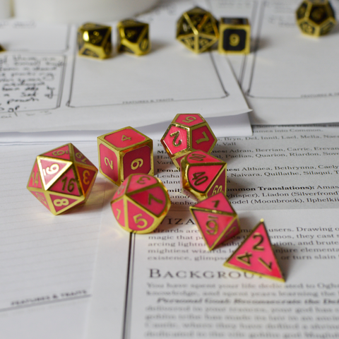 Dice Set Pink & Gold glow in the dark D&D