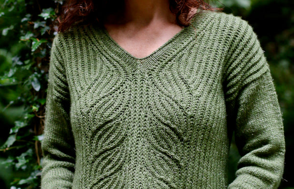 close up front detail of oa woman in a green sweater