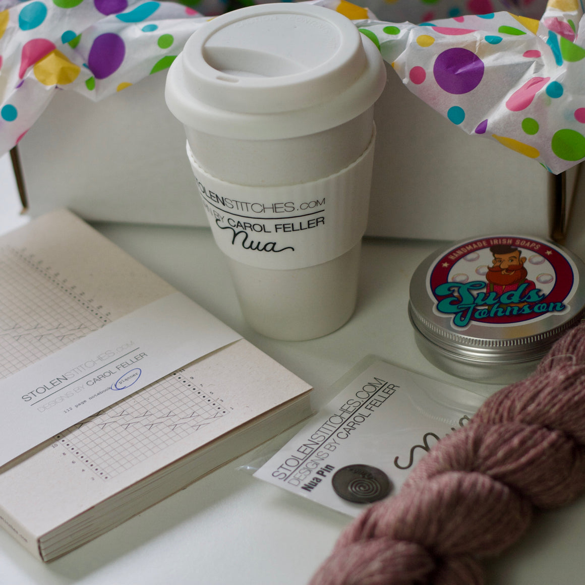 gift pack; badly made planner, bamboo cup, suds johnson soap, nua pin, nua yarn
