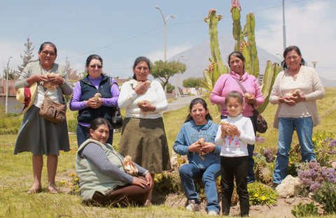 Chiri For Good's Ñaña knitters pose with their chickens #Giveacluck
