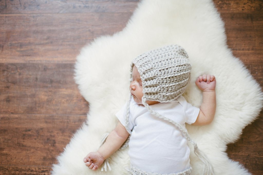newborn baby on natural rug