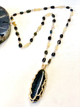 Necklace with black opals