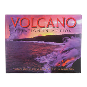 Book cover shows an orange, lavender and black scene of lava from Kīlauea volcano running and dripping into the sea, with a volcanic plume rising into the sky in the background.