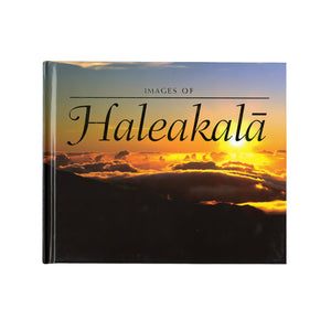 Book shows the golden sunrise over the summit valley of Haleakalā Volcano on Maui.