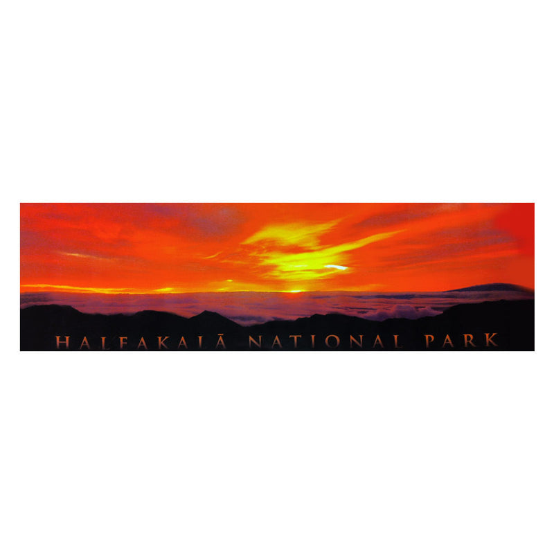 Poster is a panoramic showing the golden sunrise in an orange sky over Haleakalā volcano as seen from the summit. Clouds spill over the cliffs in the distance.
