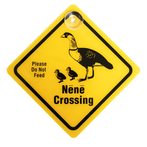 Yellow diamond-shaped placard displays the words NĒNĒ CROSSING and shows a graphic of an adult Hawaiian goose and two goslings.