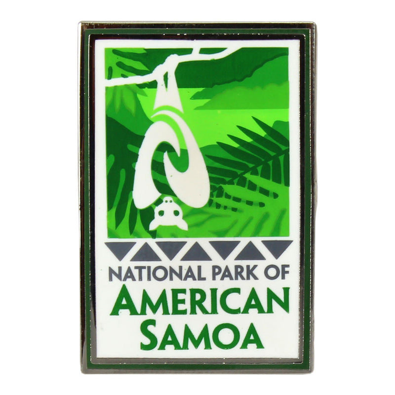 Rectangular green and white pin shows fruit bat/flying fox and rainforest logo of the National Park of American Samoa and park name.
