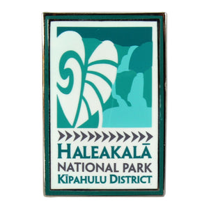 "Colorful rectangular pin done in a sleek modern style and depicting the waterfalls at Kīpahulu in Haleakalā National Park on Maui in Hawai'i. Green and white pin is enameled and measures 1.75"" by .75"""