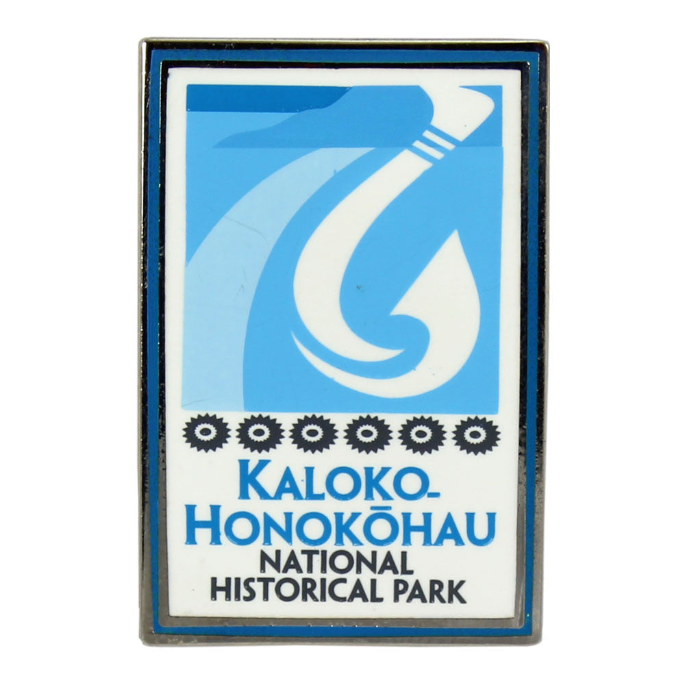 Rectangular blue and white pin shows fishhook and fishpond logo of Kaloko-Honokōhau National Historical Park on Hawaiʻi Island.