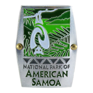 Rectangular green and white hiking medallion shows fruit bat/flying fox and rainforest logo of the National Park of American Samoa and park name in green on a white background.