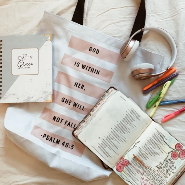 Shown with Bible Journaling Supplies, headphones and books God is Within Her, She Will Not Fall | Christian Tote | Doves x Fit | Religious Jesus Bible Accessories