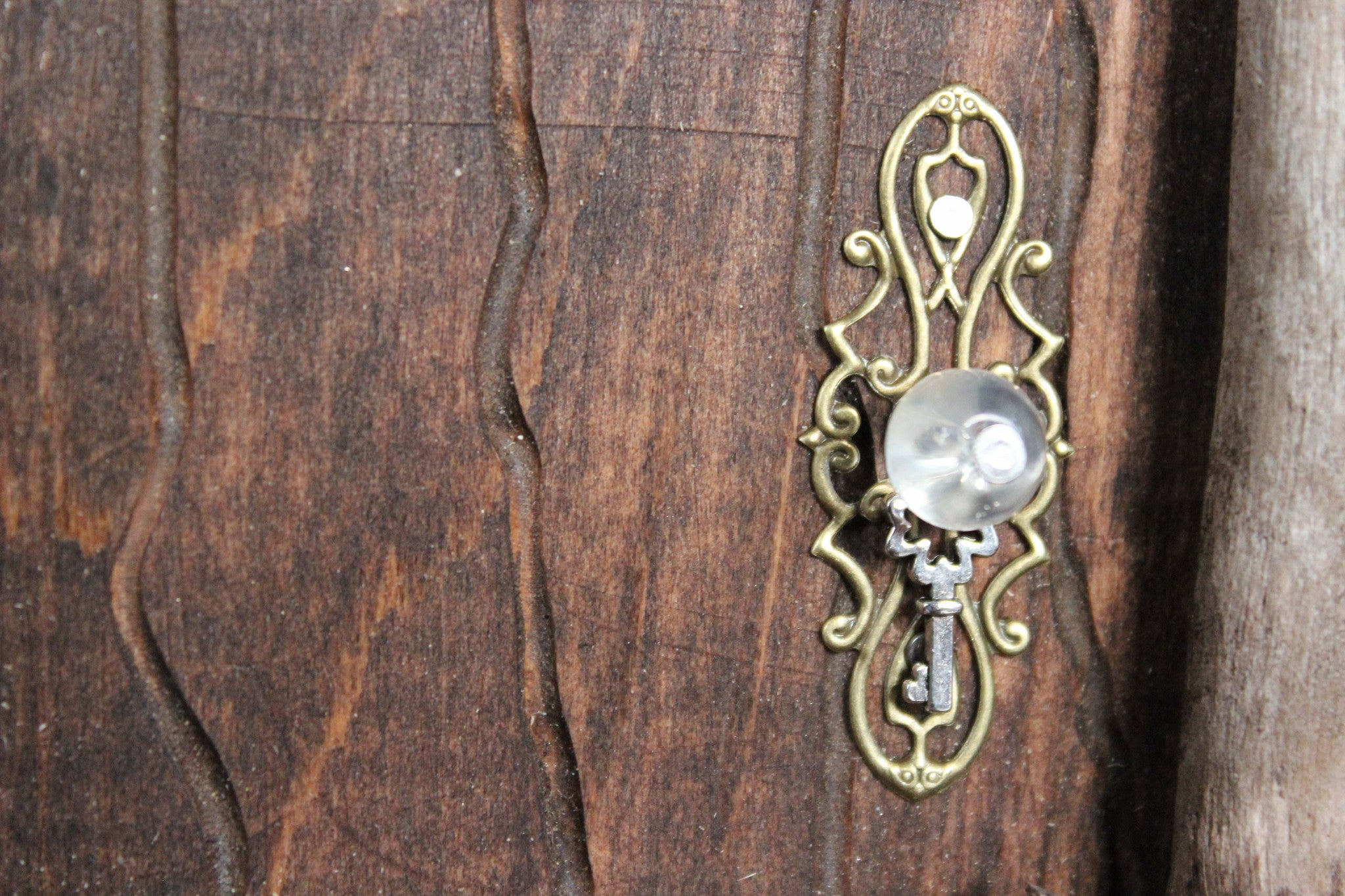 brown fairy door, doorknob, glass bead