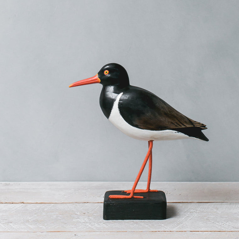 carved wooden bird oyster catcher