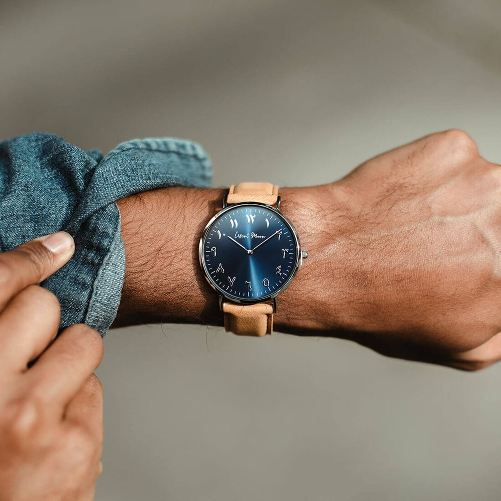Arabic Numerals Watch with Tan Leather Strap and Navy Blue Dial by Crscnt Moon shown being worn