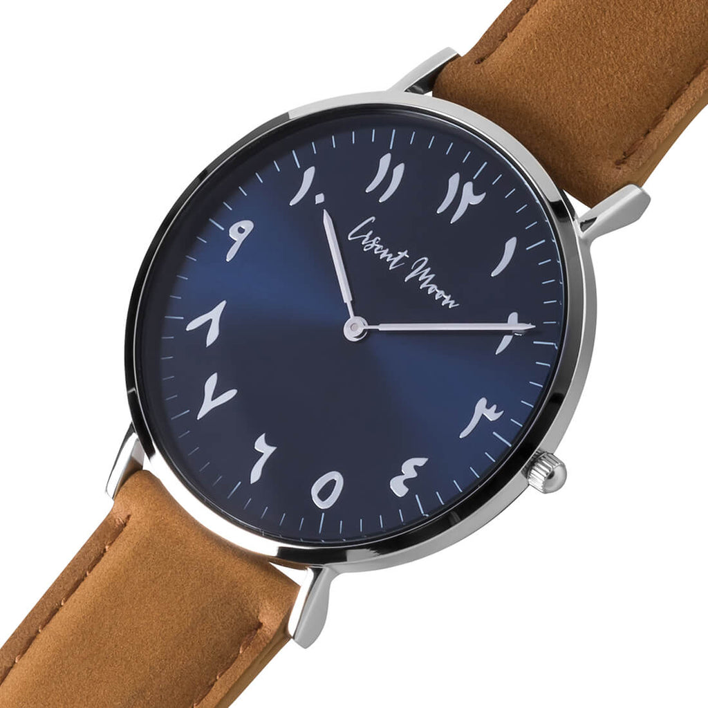Arabic Numeral Watch with Tan Leather Strap, Silver Case, and Blue Dial by Crscnt Moon. Side Angle Photo.