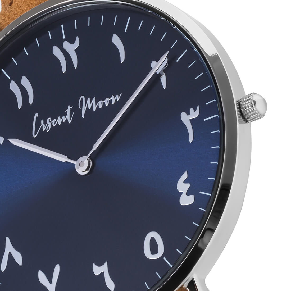 Arabic Numeral Watch with Tan Leather Strap, Silver Case, and Blue Dial by Crscnt Moon. Close Up Photo.