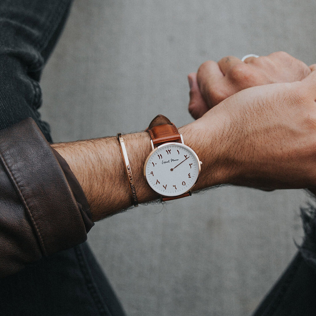 Man Wearing Arabic Numerals Watch with Brown Leather Strap and Rose Gold Case by Crscnt Moon