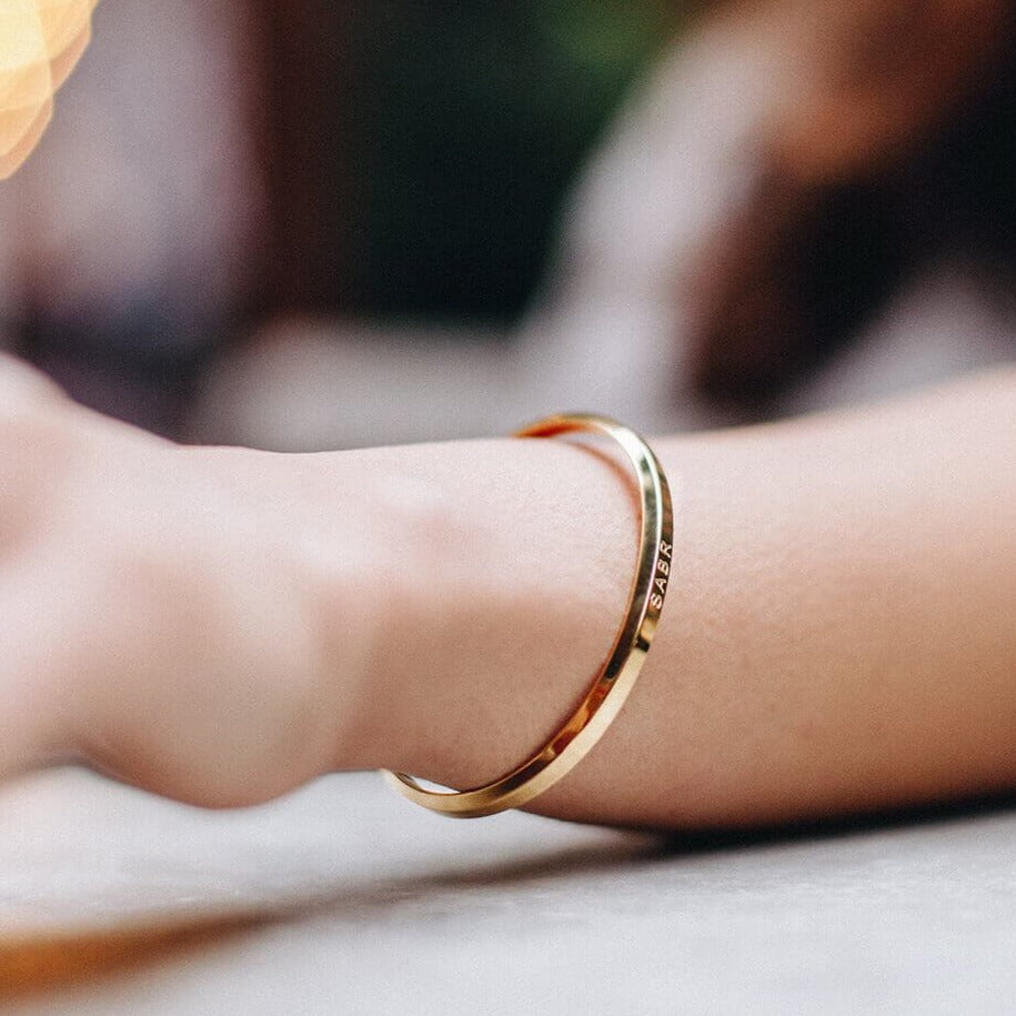 Sabr Cuff Bracelet in Rose Gold shown being worn by Crscnt Moon