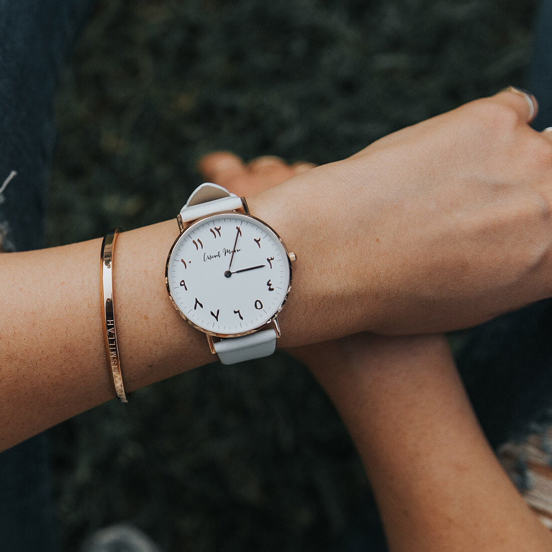 Woman Wearing Arabic Numerals Watch with White Leather Strap and Rose Gold Case by Crscnt Moon