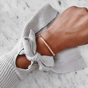Woman Wearing Bismillah Cuff Bracelet in Rose Gold by Crscnt Moon