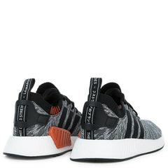 The NMD_R2 PK in Coral Black and White