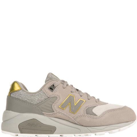 New Balance for Women: 580 Molten Metal Grey with Gold Sneakers