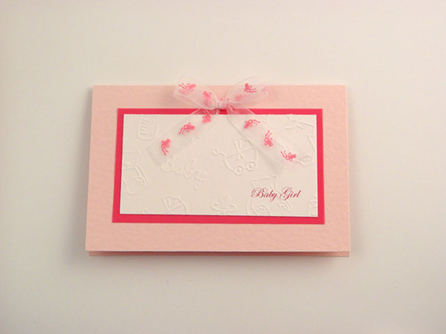 Beautiful baby girl handmade card with embossed baby motifs