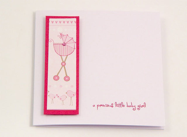 Cute handmade card to welcome new baby girls with pink buggy motif