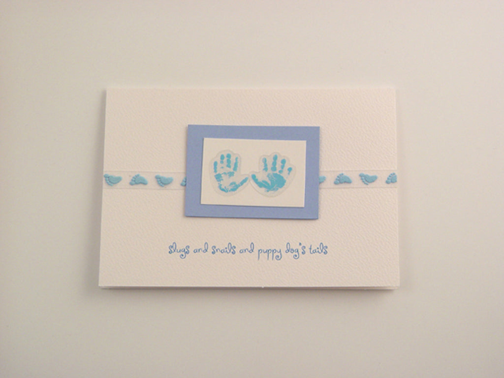 Delightful baby boy handmade card with baby motifs