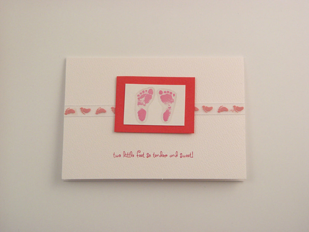 Delightful baby girl handmade card with baby motifs