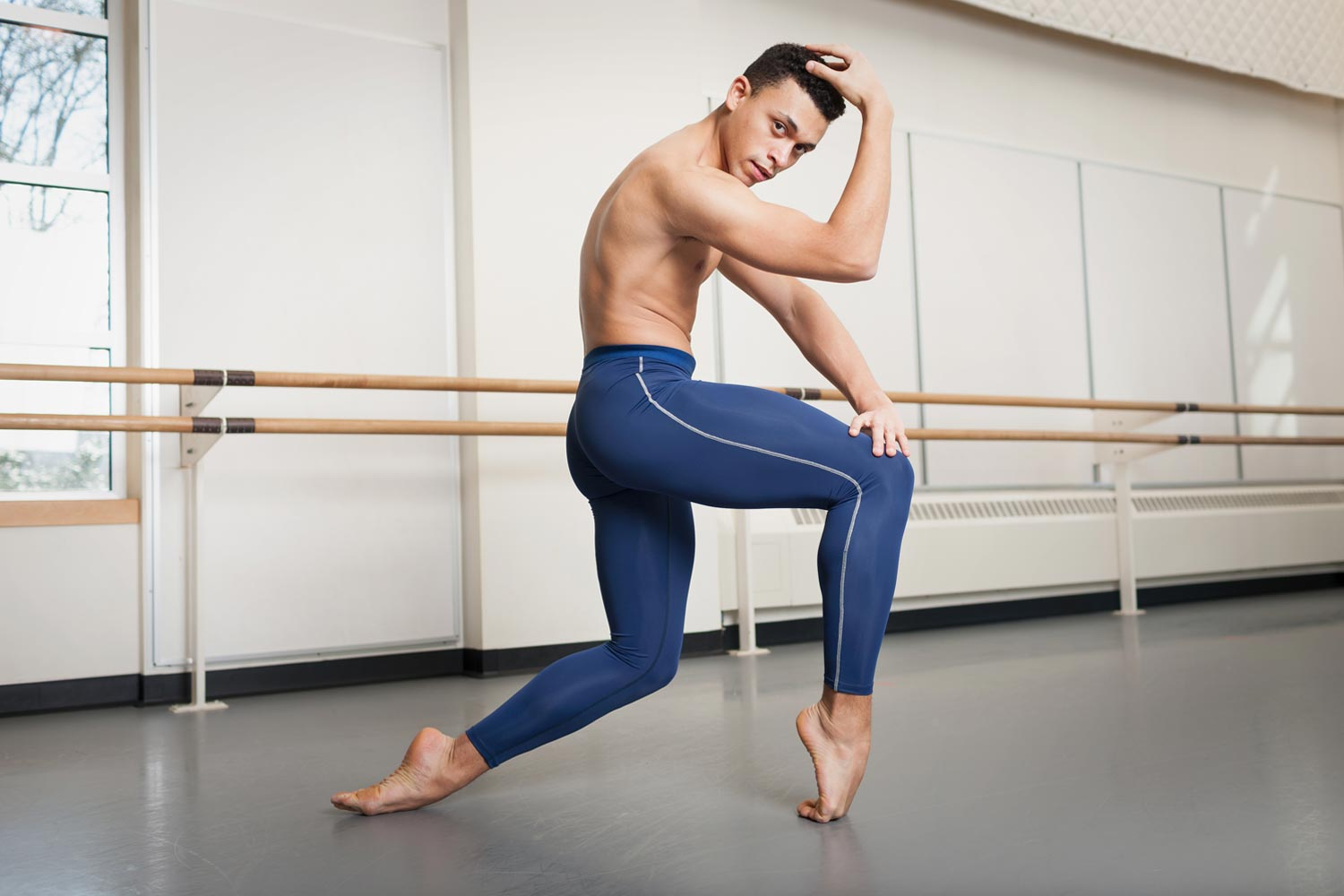 male dancer wearing ballet tights with different color stripe on the side