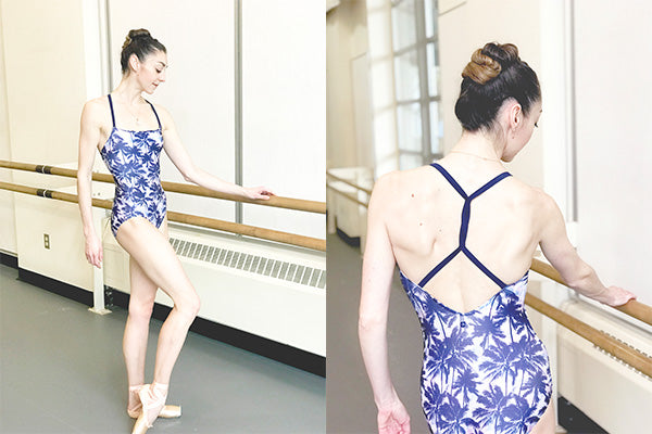 dancer wearing floral print leotard with thin straps twisted on the back