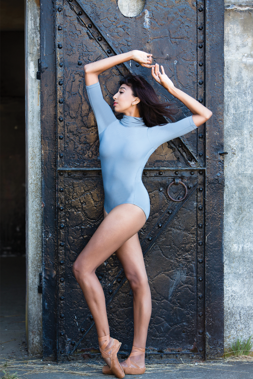 dancer wearing solid color three quarter sleeve leotard with turtle neck collar