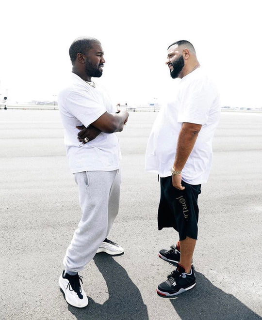 SPOTTED: KANYE WEST GIFTS DJ KHALED YZY BSKT SNEAKERS ON THE TARMAC