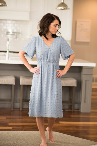 Tiff Swiss Dot Cross Front Dress in Dusty Blue