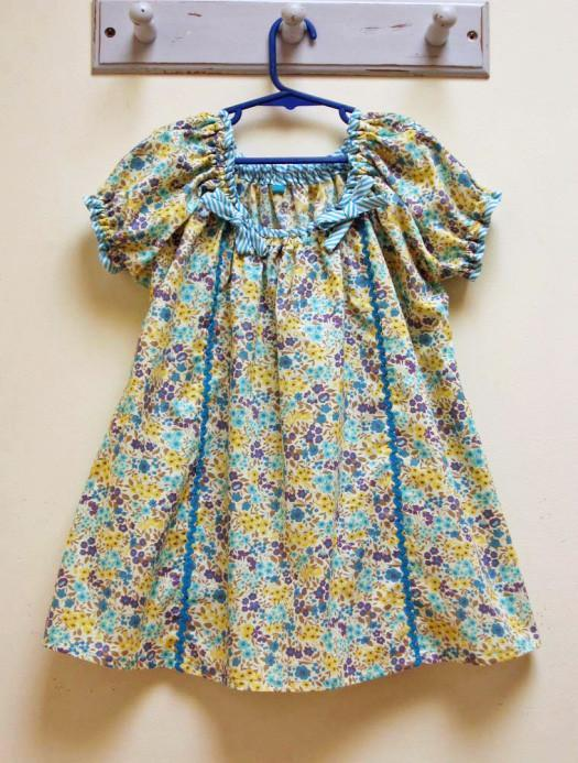 The Sweet Pea Girl's PDF Dress Pattern sizes 1 - 10 years. The Tutorial shows 3 ways to make it.
