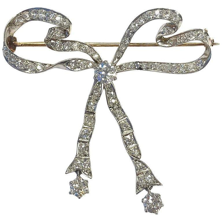 Antique 4 Carats of Diamonds Platinum Gold Articulating Bow Pin